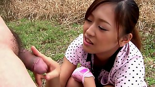 Japanese teen is on her knees sucking cock..